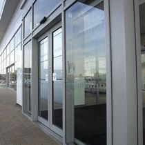 Eingangstür / zum Schieben / Glas / mit Sicherheitsvorrichtung