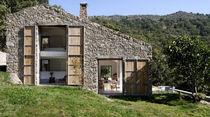 Tipen-Haus / aus Beton / aus Metall / aus Kalkstein