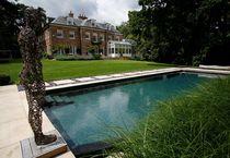 Erdverlegtes Schwimmbecken / Beton / Natur / für Außenbereich