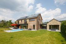 Fertigbauhaus / aus Massivholz-Block / modern / aus Holz