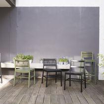 Moderner Stuhl / Gewebe / Holz / Leder