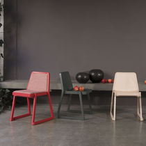 Moderner Stuhl / Gewebe / aus Buche / Leder