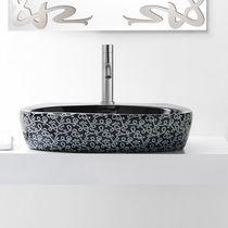 Aufsatzwaschbecken / oval / aus Keramik / modern