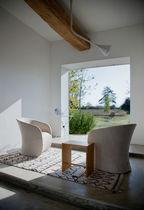 Moderner Sessel / Kuhfell / Textil / Leder