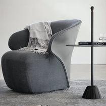 Moderner Sessel / Kuhfell / Leder / Textil