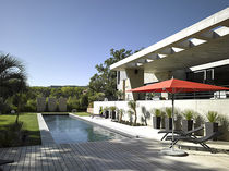 Erdverlegtes Schwimmbecken / Beton / Schalung Polymer / Wellen