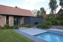 Erdverlegtes Schwimmbecken / Beton / integrierte Abdeckplane / für Außenbereich