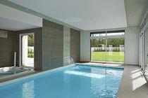 Erdverlegtes Schwimmbecken / Beton / für Wellnesscenter / Innenbereich