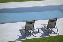 Erdverlegtes Schwimmbecken / Beton / für Wellnesscenter / mit Spiegeleffekt