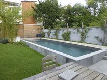 Teileingebautes Schwimmbecken / Beton / für Außenbereich