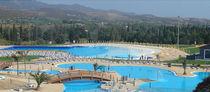 Erdverlegtes Schwimmbecken / Beton / für Aquapark / Wellen