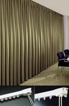 Vorhangschiene mit Leinenbetätigung / zur Wandbefestigung / für drapierte Vorhänge / für berufliche Nutzung