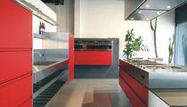 Moderne Küche / aus Edelstahl / Laminat / Kochinsel