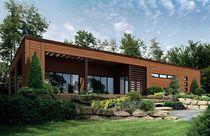 Fertigbauhaus / aus Massivholz-Block / modern / MOB