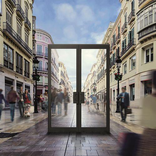 Eingangstür / drehend / Aluminium / wärmeisoliert
