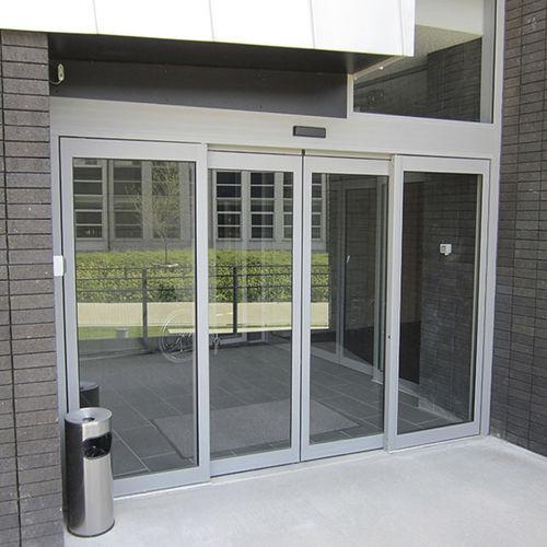 Eingangstür / einflügelig / Schiebe / Glas