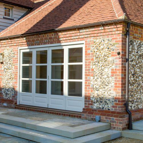 Eingangstür / faltbar / Holz / isolierend