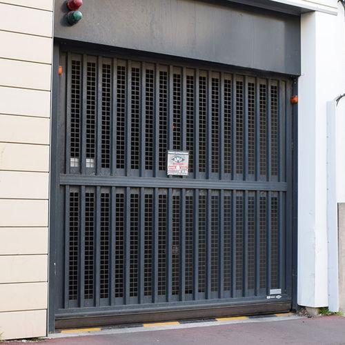 sektionale Garagentür / zum Kippen / vertikal Schiebe / faltbar