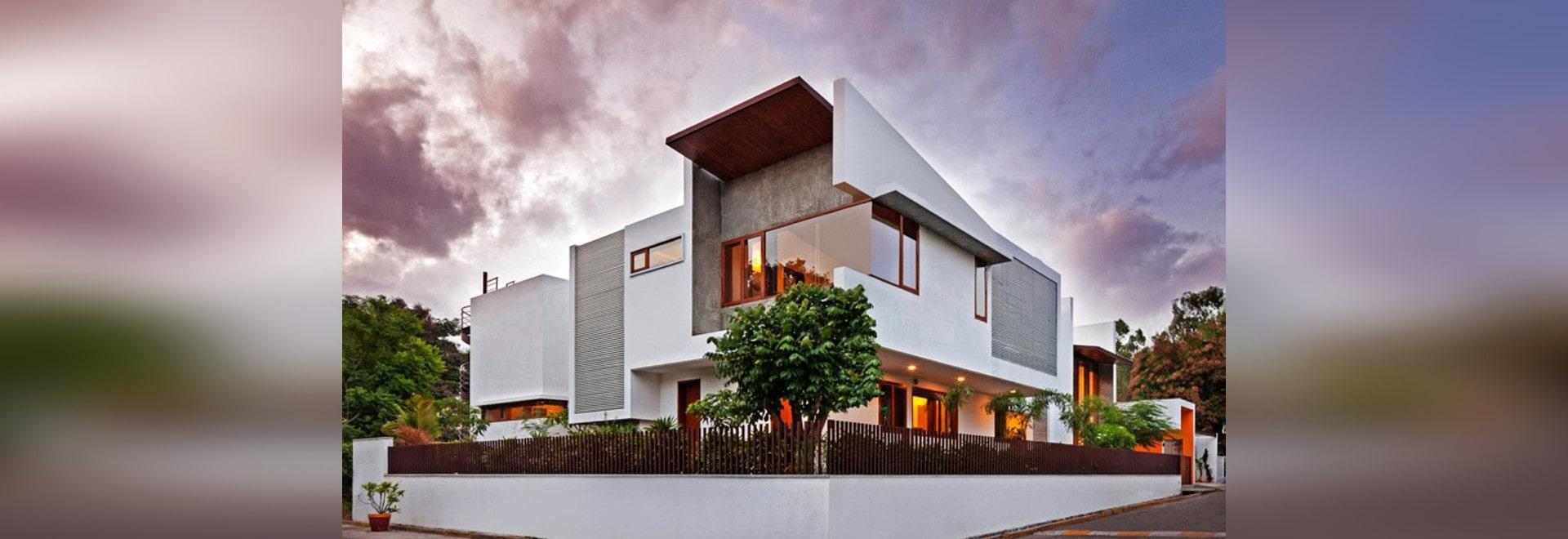 Dieses L-förmige Haus? s-doppelte Höhen-Wohnzimmer öffnet sich zum ...