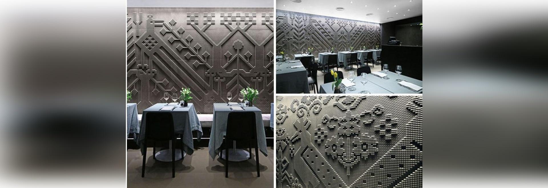 Gemeißelte Steintapisserien bedecken die Wände dieses Restaurants in London