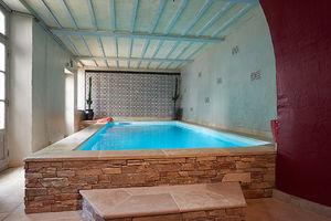 Schwimmbecken zum Aufstellen / Beton / Stein / Innenraum