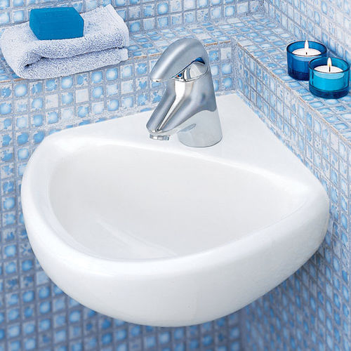 Wand-Waschbecken / für Eckeinbau / Ton / modern