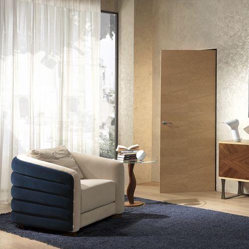 moderner Sessel / Stoff / Leder / beige
