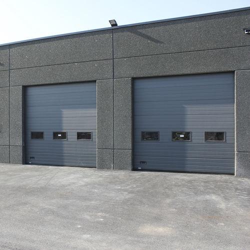 sektionales Industrietor / Metall / automatisch / mit Sicherheitsvorrichtung