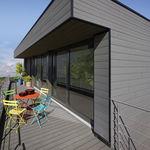 Fassadenverkleidung aus Lamellen / PVC / geriffelt / Holzoptik