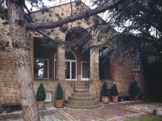 Ein Tribut zu Palladio in dem dreiteiligen? Serliana? wölben Sie sich auf dem Garten façade, mit seinem konvex-konkaven Treppenhaus. (Foto: Lukas Roth)
