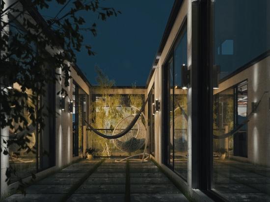 """Milad Eshtiyaghis freitragendes """"Berghaus"""" schlängelt sich dreidimensional über eine Klippe"""