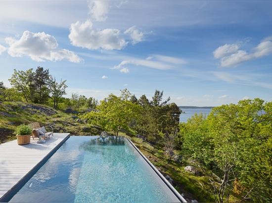 die Wohnung schaut heraus über den Treetops in Richtung zum Stockholm-Archipel